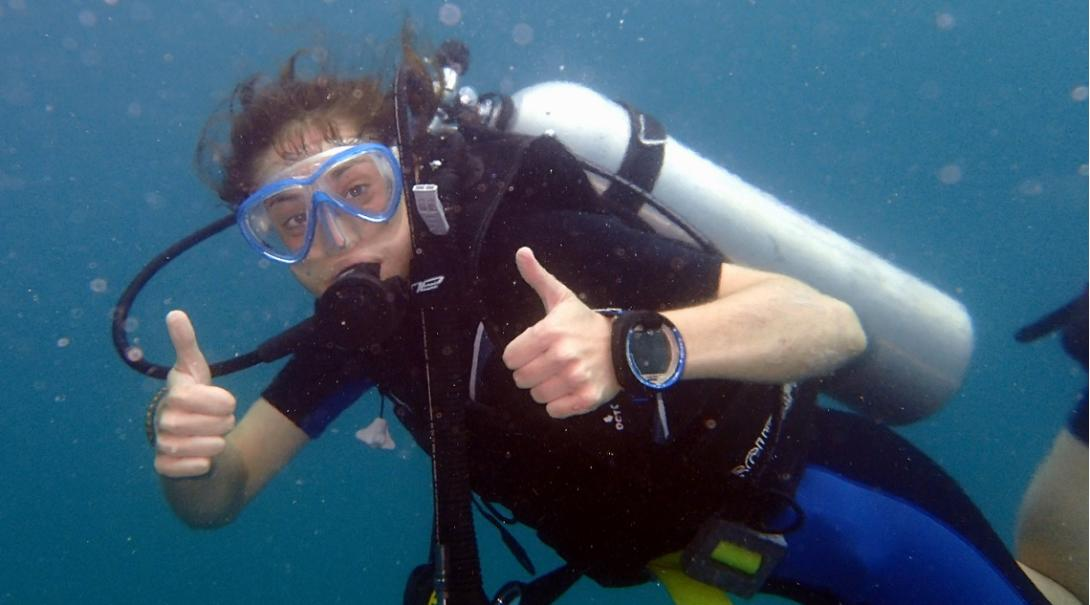 Volunteer gives a thumbs up during her Conservation Project abroad